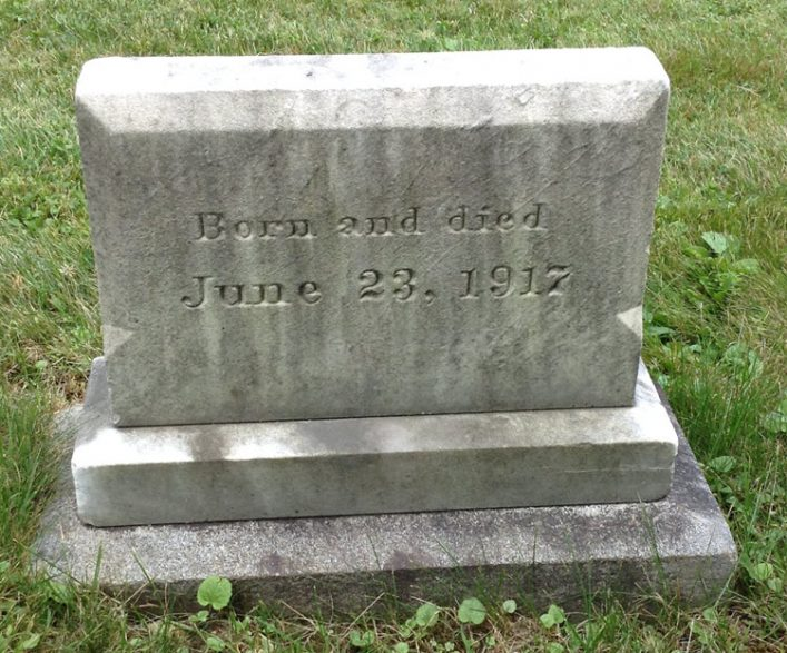 """Headstone reads: """"born and died June 23, 1917"""""""