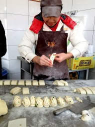 They fold and roll all their buns by hand. I went back on day 2 to observe again and they were working on filled buns. Exciting to watch.