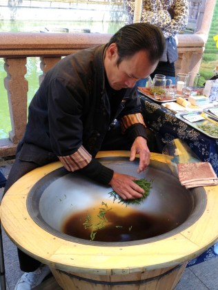 This gentleman was mixing tea by swirling it around in this giant dish