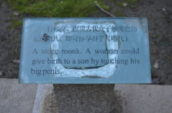 Stone monk plaque.