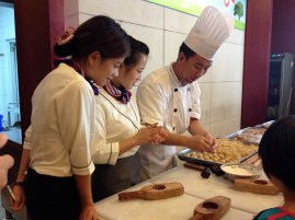The Chef patiently teaches each child what to do.