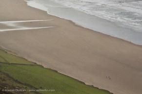 People on Rhossili Beach
