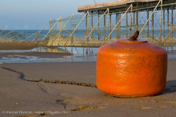Object on the beach at Colwyn Bay