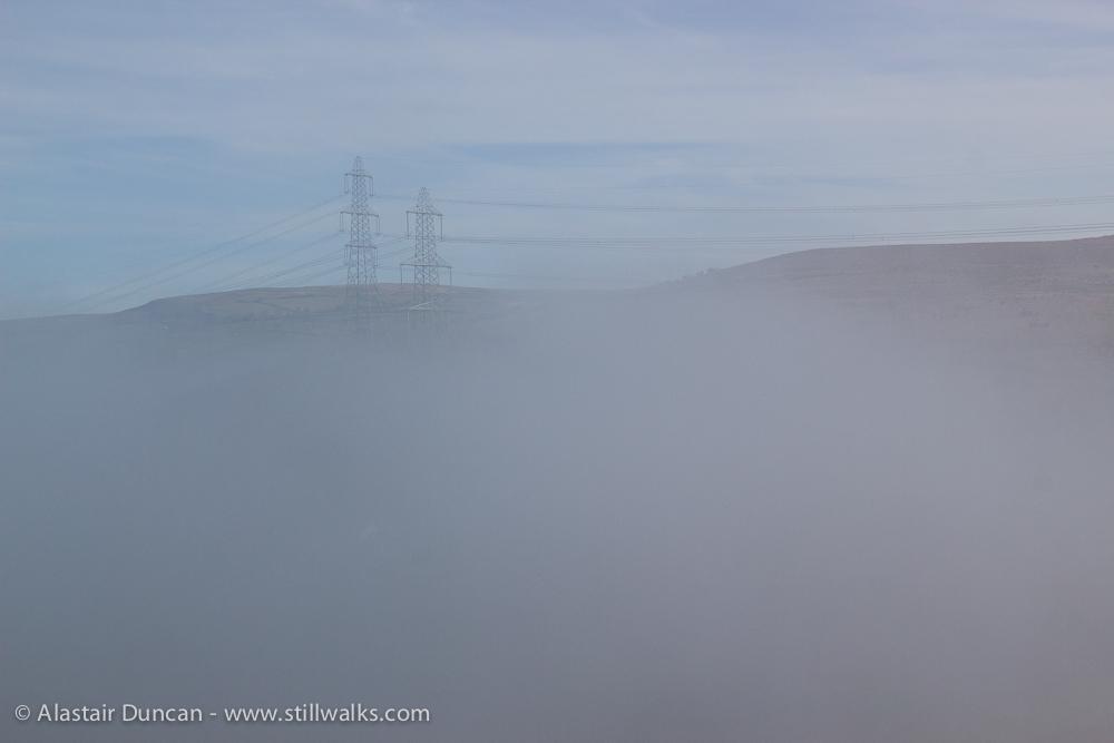 hillside through mist