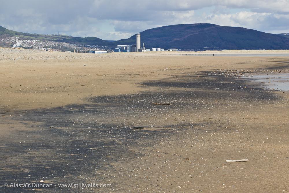 beach with black sand or coal dust