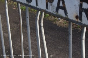 road sign and railing
