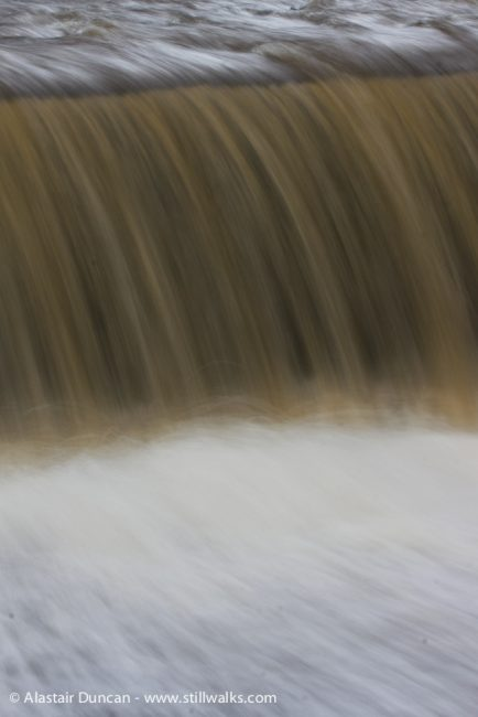 water falling over weir