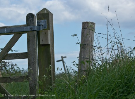 Pagham Stile against the sky