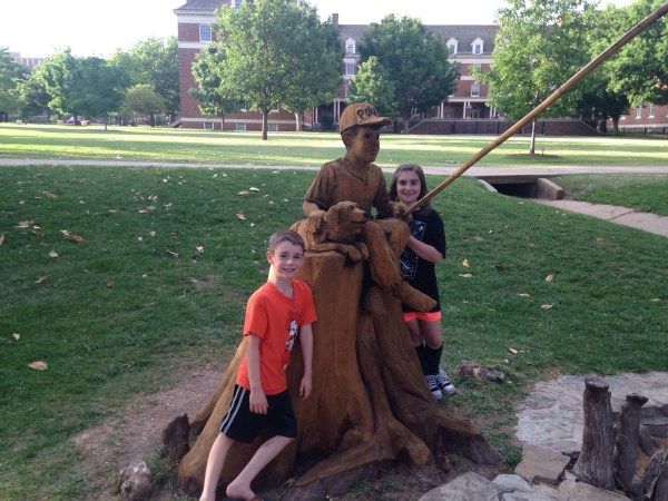 The Longan kids also visited the carved tree stump located by Theta Pond. The tree had been struck by lightning and was carved by Oklahoma chainsaw artist Clayton Coss. Photo courtesy of Jessica Longan.