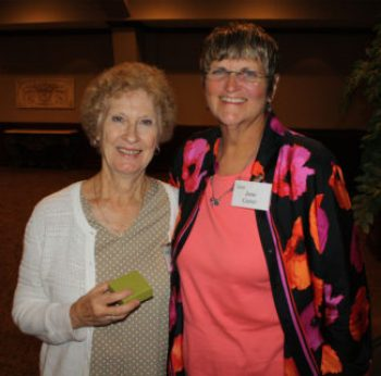 Judy Henderson, pictured here with garden manager Jane Carter on the left, was recognized for 20 years of volunteer service in The Botanic Garden at OSU.