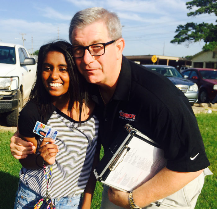 Rainier Jeffery with Brad Finley after passing her Driving Test.