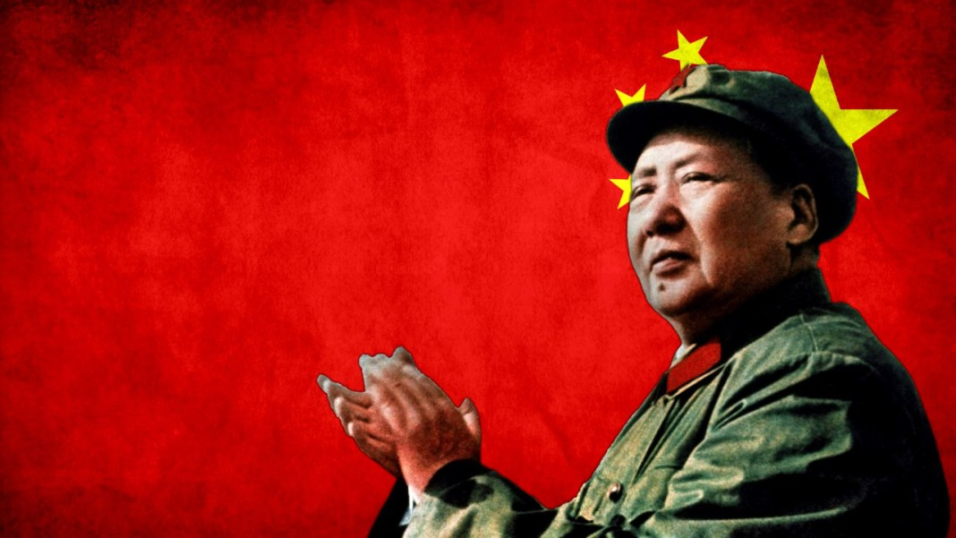 Mao Zedong against a red China flag.