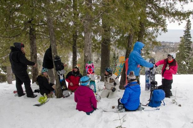 Friends taking a break on the mountain