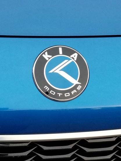 kia motors badge on blue stinger