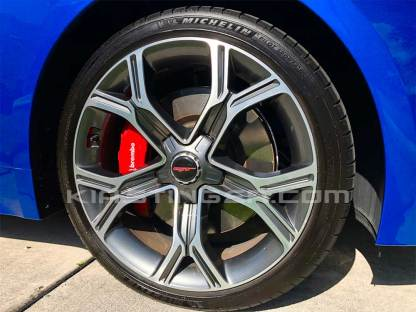 red and white gt wheel cap overlay for kia stinger