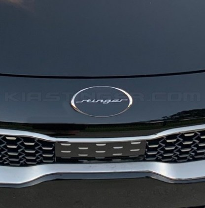 oval stinger emblem on front of kia