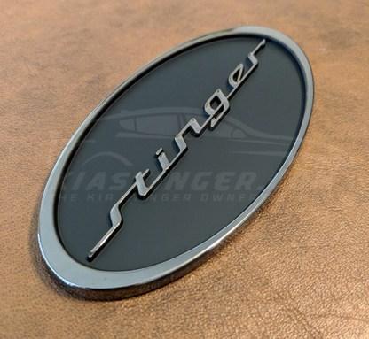 Over Stinger badge in black chrome