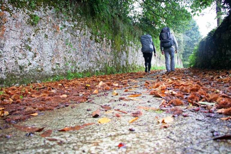 Campbell and Alya walking through a small village in Asturias on the Camino del Norte