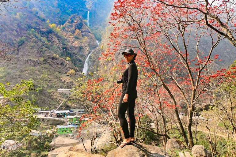 Alya with Syange waterfall on the background