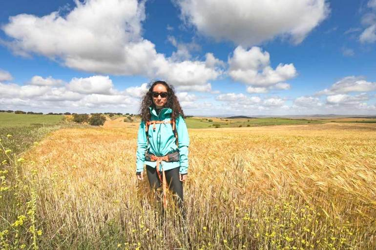 Alya surrounded by endless golden fields of wheat