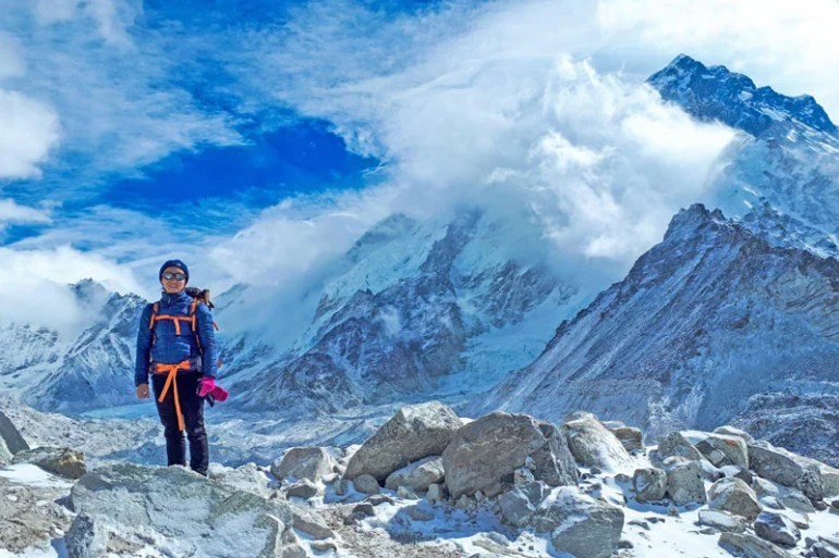 Alya with Mount Everest in the background.