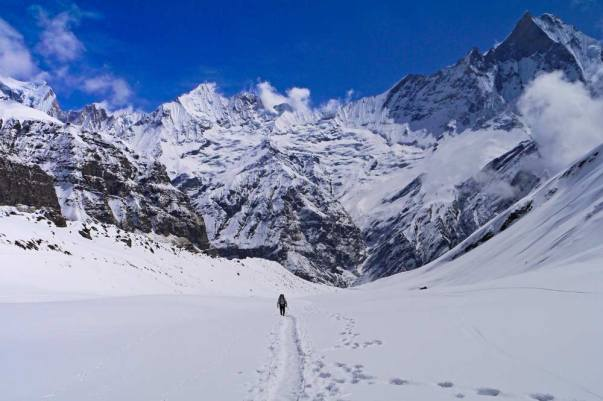 Campbell surrounded by the snowy mountains on his way to Annapurna Base Camp