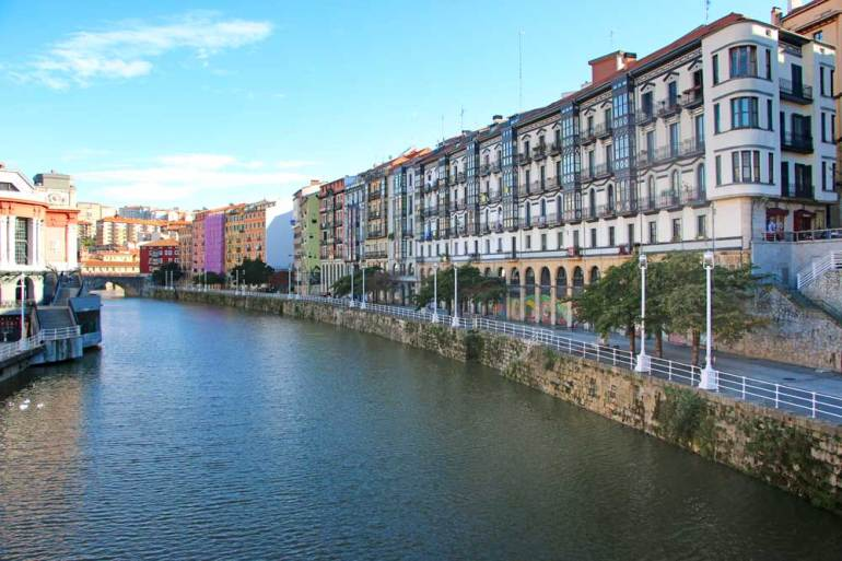 Colorful houses along the river bank in Bilbao, Spain