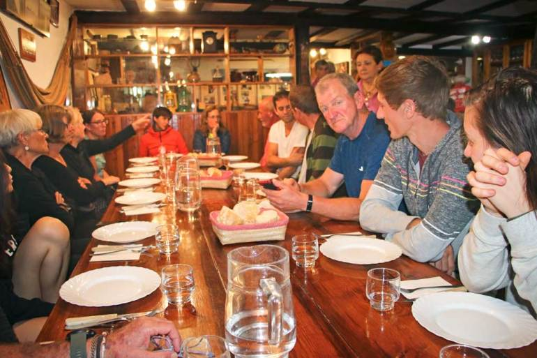 A communal dinner for pilgrims at private albergue in Guemes on the Camino del Norte