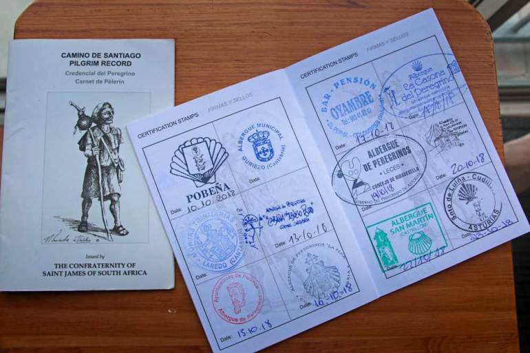 Our Credentials with stamps from public and private albergues on the Camino de Santiago