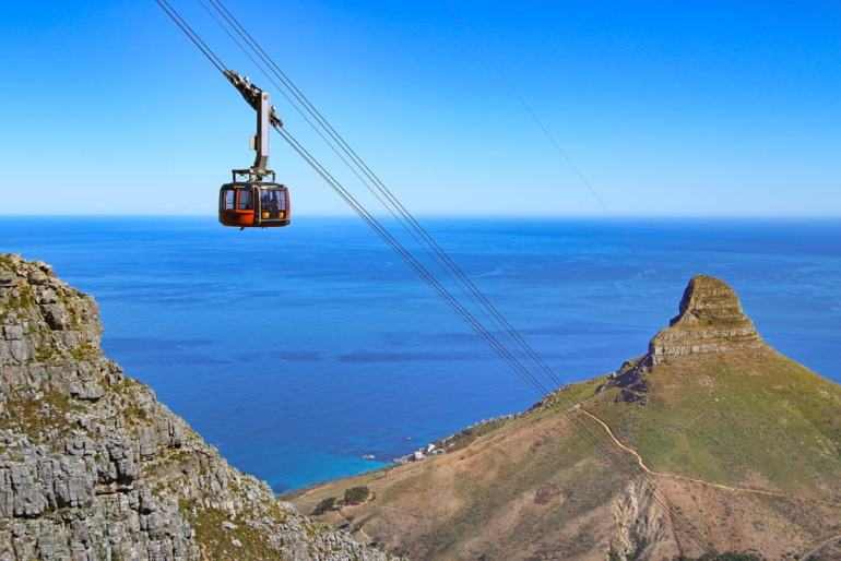A view of the cable car and the coast on the way up Table Mountain following the India Venster route