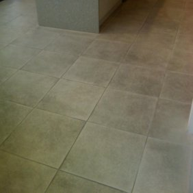 Textured Ceramic Tiled Shop Floor Before Deep Cleaning Stirling