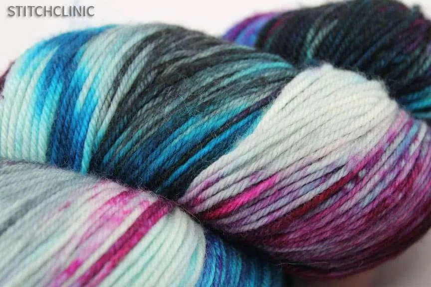 Natural Fiber yarn - 100% Merino Wool in black, whitr, purple, magenta and cyan.