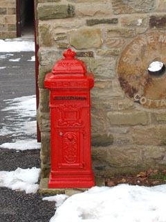 Post box near one of the cottages