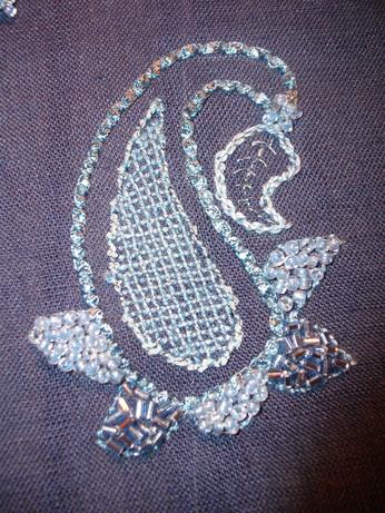 Stitches used - couching, running stitch, chain stitch and lattice