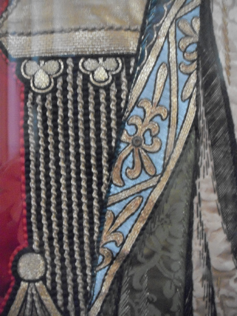 Detail from one of the gowns