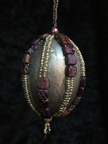 Silver and glitter painted egg with bead embellishments.