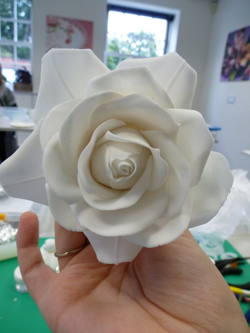 The large rose after attaching the outer petals