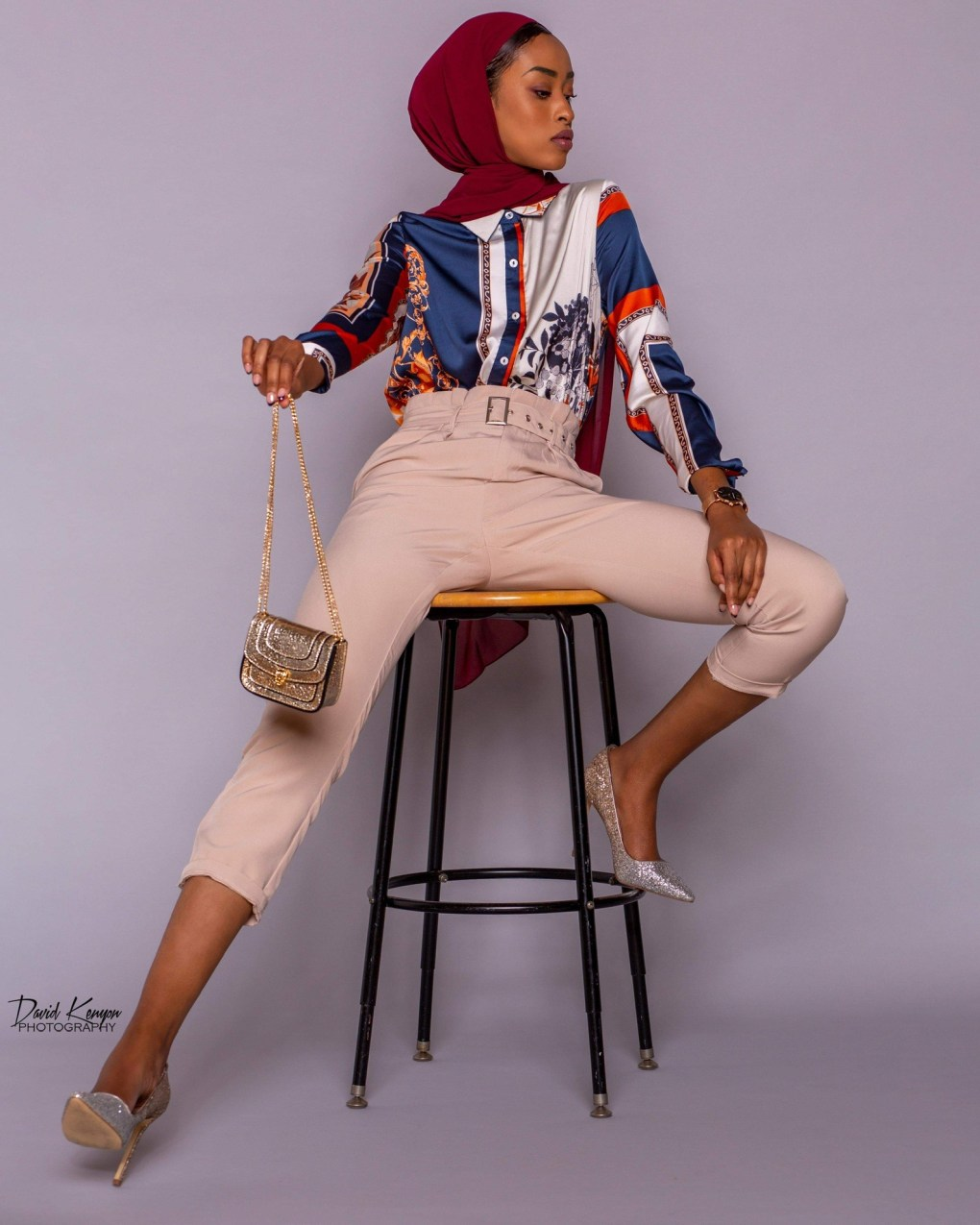 fashon model sitting on stool