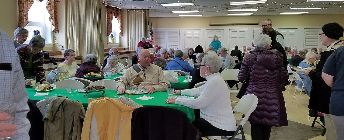St James Church Parish Hall full of community folks for lenten community service luncheon