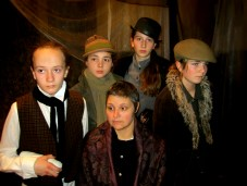 Dee Bellinger as Tiny Tina, Shelly Murdock as Emily Cratchit with Street Urchins Sloane Ryan as Nipper, Grace Brunet as Dolly and Jillian LeBel as Cager