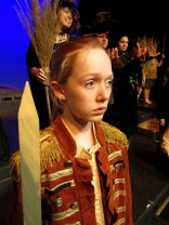 Caroline Silver as Lorcan Gallagher, looks on in the ORCHARD OF HIDE & SEEK.