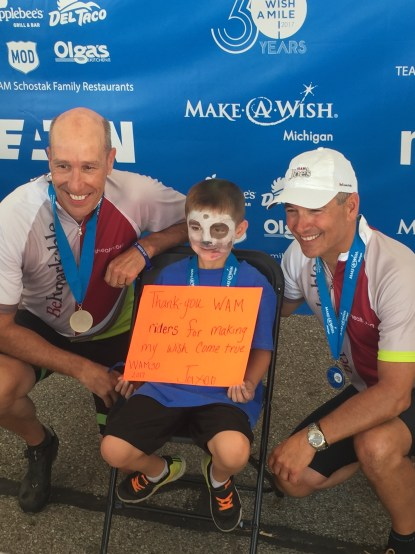 David Williams (at left), CEO of Make-a-Wish America, Wish Child Jaxon, and SJMHS CEO Rob Casalou.