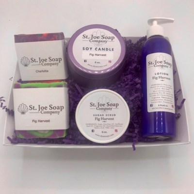 image of Fig Harvest Gift Basket with assorted soaps, candles, sugar scrub and lotion, and bath bomb