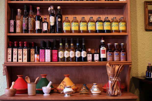 The Olive & Vine shop with a display of gourmet olive oils and aged vinegars.