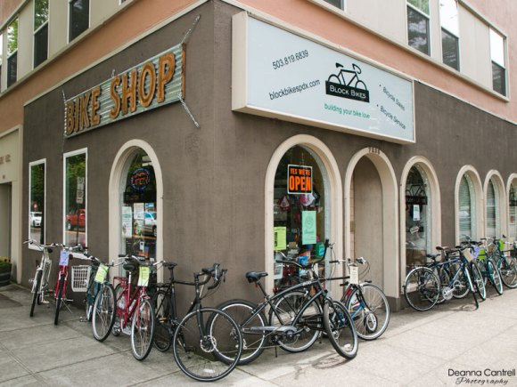 Entrance to Block Bikes PDX with bicycles set out along the building.
