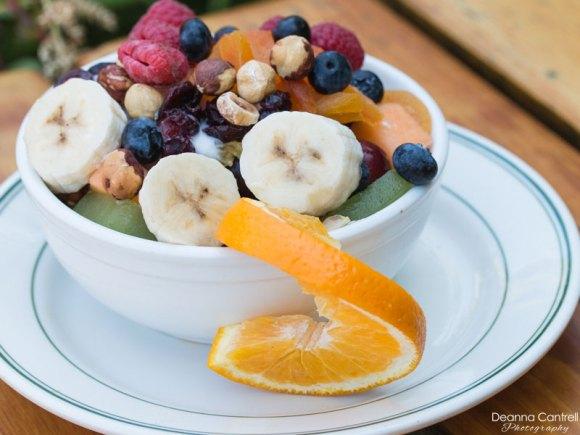 Fresh fruit bowl with yogurt and nuts.