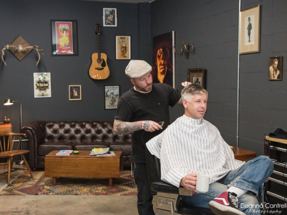 Barber and client.