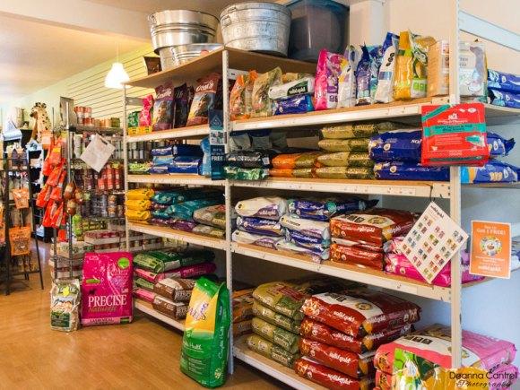 Shelves of dog food, interior of Tre Bone.
