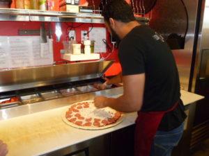 Abdul Alhoti making pizza