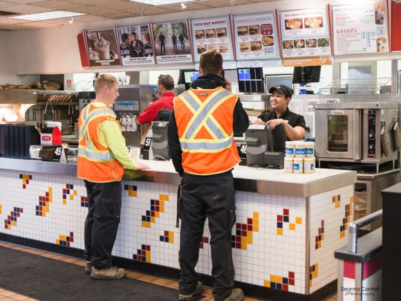 Interior of St. Johns Burgerville with customers ordering food.